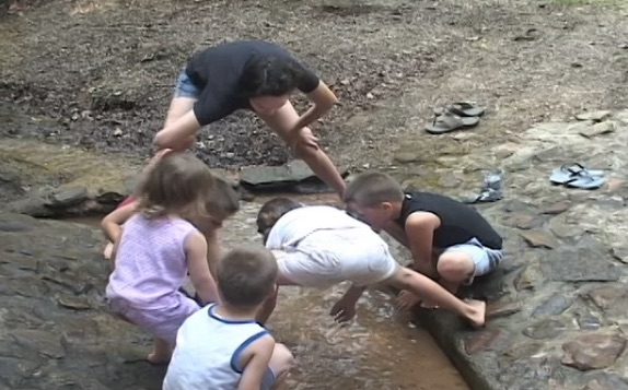 Four kids playing in water