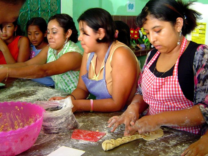 Latina women cooking together.