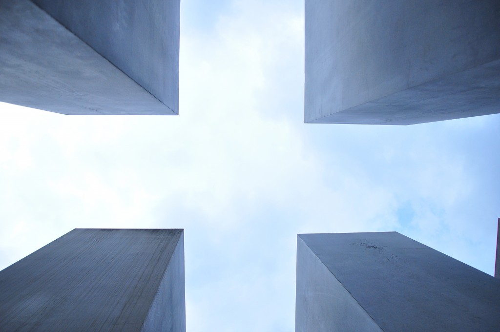 Skyscrapers outlining a cross symbol in the sky.