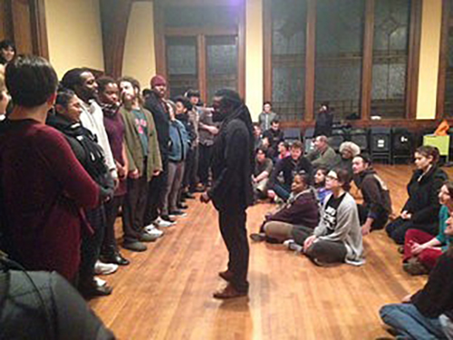 Photo of Rev Sekou training young adults