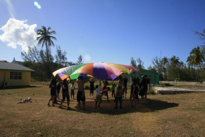 Students with Parachute on Exuma Mission Trip