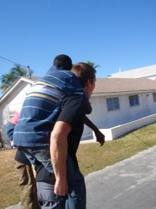 Student giving piggyback ride