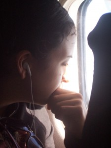 Student on plane with iPod