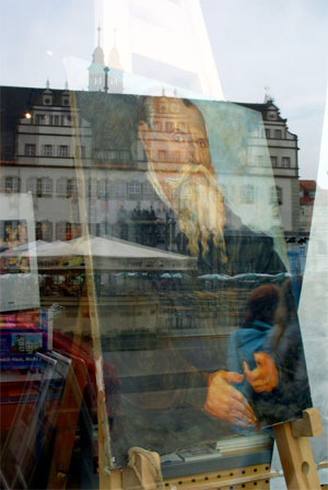 A self-portrait of Lucas Cranach, shop window, Wittenberg. Photos by author.