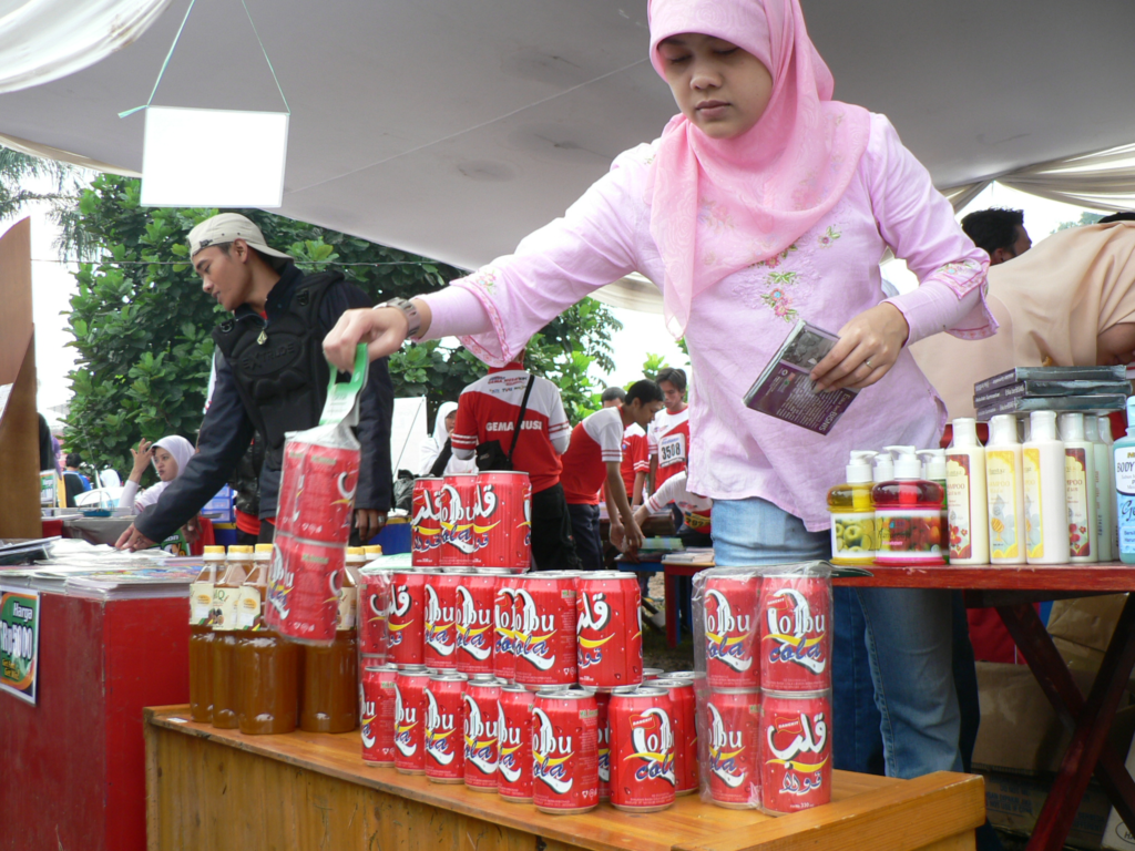 Girl lifting cans of cola