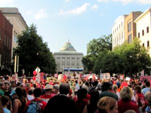 A large crowd of protesters stands in front of the North Carolina capitol