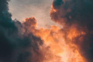 Fiery light appears between two dark clouds