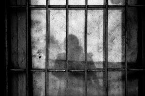 Shadow behind bars